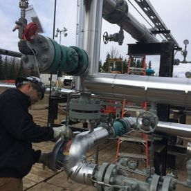 man working on pipeline insulation